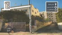 مبنى تجاري مؤجر للبيع في وادي صقرة