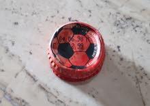 سدادة قنينة كوكاكولا