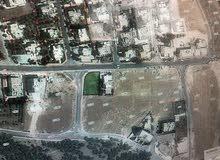 ارض استثمارية على شارعين  في الجويدة تصلح لبناء اسكان  على شارعين ( كورانا زاوية )  للبيع