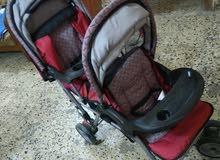 عربة اطفال مقعدين + كرسي
