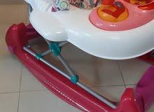 للبيع عربة تعليم المشي وتصلح كرسي هزاز بحالة ممتازة
