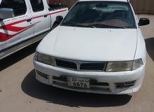 White Mitsubishi Lancer 1999 for sale