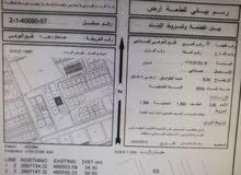 صناعيه في فلج العوهي صحار وامامها شارع والواجهة الاناميه والخلفيع طولها 50 متر و