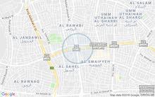 ارض تجاري محلي على شارعين قرب الدوار السابع واجهه 50 متر