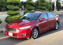 سيارات فورد فيوجن 2014 جديد لون خمري كاش فقط جير اوتوماتيك للبيع في الأردن