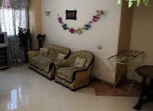 شقة للبيع 6 أكتوبر الحي السابع شارع أحمد راتب أرضي مرتفع