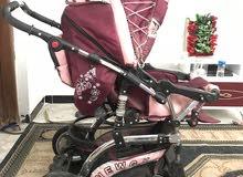 عربة اطفال ومقعد جديد غير مستعمل