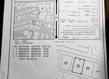 ارض بصحار قرب الشارع العام
