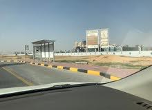 (بالتقسيط) تملك ارض تجارية بتصريح ارضي +6 طابق علي طريق الشيخ محمد بن ذايد وجامعه الوطن