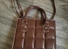 حقيبة يدوية  بنيه نسائية
