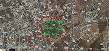 ارض مساحة نصف دونم للبيع منطقة الراهبات الوردية اربد اجمل منطقة للسكن