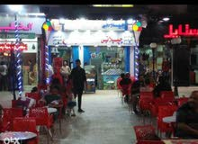 محل تجاري للبيع بالهانوفيل علي الشارع الرئيسي