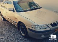 Manual Mazda 2000 for sale - Used - Sohar city