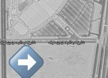 مدينة الدمام : للبيع ارض قرب النخيل مول