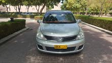 Silver Nissan Versa 2011 for sale