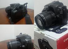 للبيع كاميرا كانون 1100 مع عدسة 18_55 وللتواصل