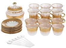 طقم زجاجات شاي فاخر مكون من 26 قطعة، من المرجان، بلون ابيض وذهبي جديد ولم يستخدم