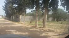 ارض للبيع 400 متر عين زارة طريق المشتل بالقرب من سوق الغزيوي