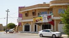فرصة استثمار /بيت مع دكاكين للبيع/ خلف بلدية بكرةجو/ السليمانية
