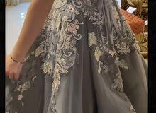فستان خطوبة ملبوس مرة واحدة فقط