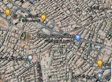 مطلوب قطعة ارض تجاري في شارع المدينة المنورة او جبل عمان