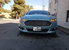 For a Month rental period, reserve a Ford Fusion 2014