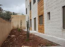 شقة ارضية مع حديقة للسكن او الاستثمار للبيع في ضاحية الامير علي قرب بيت المقدس