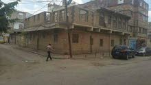 عشر لبن حي شارع الجزائر ركنية شارعين قريب شارع بغداد