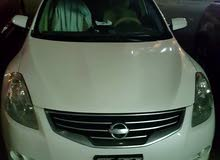 Nissan Altima 2.5 S , white, automatic , 2011 model, only 116000km driven, very good condition