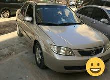 مازدا 323 موديل 2002 بحالة جيدا