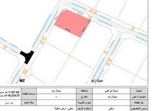 ارض سكنية على زاوية وشارعين في مدينة زايد حي العاصمة (خليفة ج)