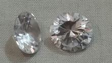 Zircon - weight 10.04 caret - color white oval - diamond cut