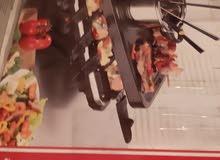 طباخ كهرباءي الماني الصنع ياتي معه 12 طاوة صغيرة وشياش كما موجود في الصور