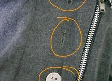 مطلوب مكينة خياطة اللي تعمل الثقوب والفتحات للازرار للقمصان