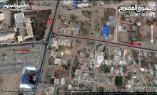 ارض بتاجوراء قريبة من سوق الخضرة على الطريق المعبد مساحه 1250م
