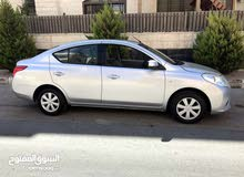 Rent a 2014 Nissan Sunny with best price