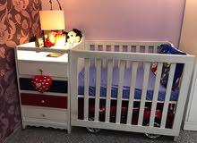 سرير طفل تكمه