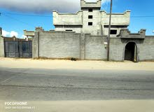منزل وشقتين للبيع بجوار نادي النجم الريفي  (أبوروية)