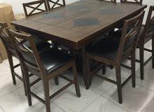 طاولة طعام قابلة للتكبير مع الكراسي