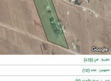 ارض 10 دونم للبيع في قرية فاع قريبه من شارع اربد المفرق الرئيسي