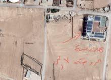 ارض مساحته دونم واحد وسط البلد بجانب مدرسة روضة بسمه الأولى للبنات ....