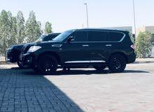 Mint condition All-Black on Black SE Nissan Patrol 2013 Glossy shiny Rims