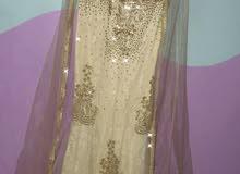 فستان ملكة ذهبي