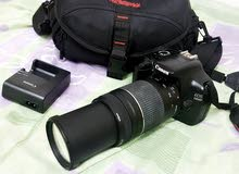 canon  camra  weth 75-300mm  zooming lens  charger  bag.