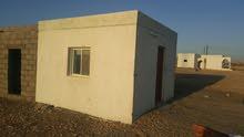 للبيع ارض سكنية مساحتها 5714 وفيها منزل قايم صغير وقريبة من شارع مطلوب 14800