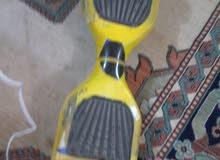 سكوتر للبيع بس مصبوغ ابلون اصفر ولون الحقيقي ازرق السعر 60