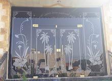 شركة الحارس لسيكوريت تركيب أبواب سيكوريت بلكونات ستيل مناور شورات رسم على زجاج