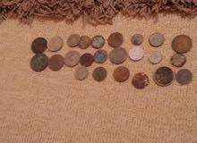 مجموعة عملات قديمه اغلبها عملة المملكه الليبيه