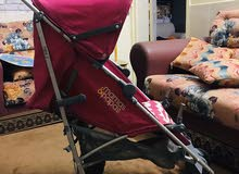 baby trolly in baby dark pink color