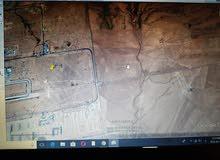 ارض للبيع خلف المطار مباشره ب 2 كم